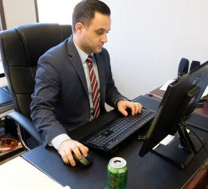 Fire & Flood Attorney Working at Desk